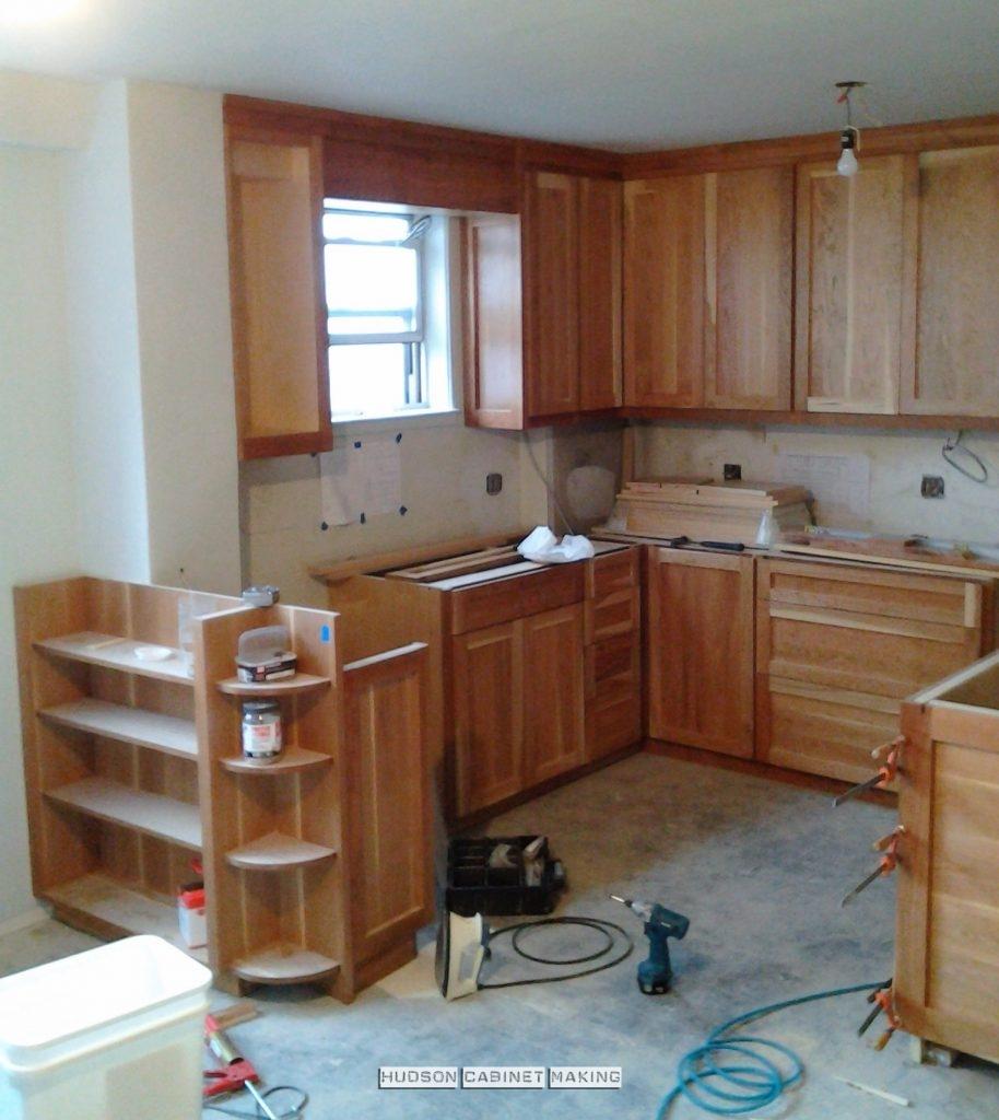 installing a custom made, cherry kitchen