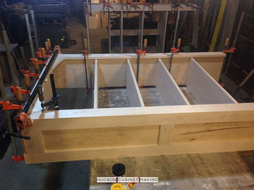 cabinet shelving being glued together